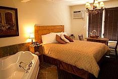 Chambres suites foyer baignoire remous double for Chambre avec bain tourbillon montreal